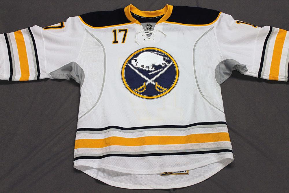 Linus Omark Game Worn Buffalo Sabres Away Jersey.  Serial: 1129-1. Set 2 - Size 54.  2013-14 season.