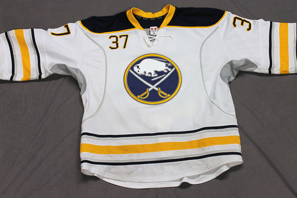Matt Ellis Game Worn Buffalo Sabres Away Jersey.  Serial: 1065-1. Set 2 - Size 56.  2013-14 season.