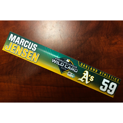 Photo of Marcus Jensen Game-Used 2019 A.L. Wild Card Locker Nameplate