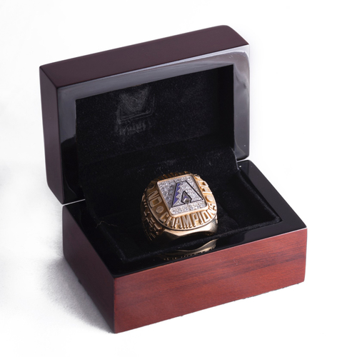 Photo of 2001 Arizona Diamondbacks World Series Ring. Winning bidder can pick up item from Bryce Harper and current Nationals Assistant GM and then Diamondbacks executive, Bob Miller on September 24, 2018