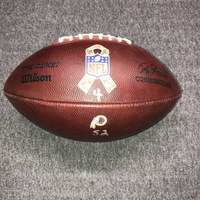 STS - REDSKINS GAME USED FOOTBALL W/ STS RIBBON LOGO AND REDSKINS LOGO (NOVEMBER 12, 2017)