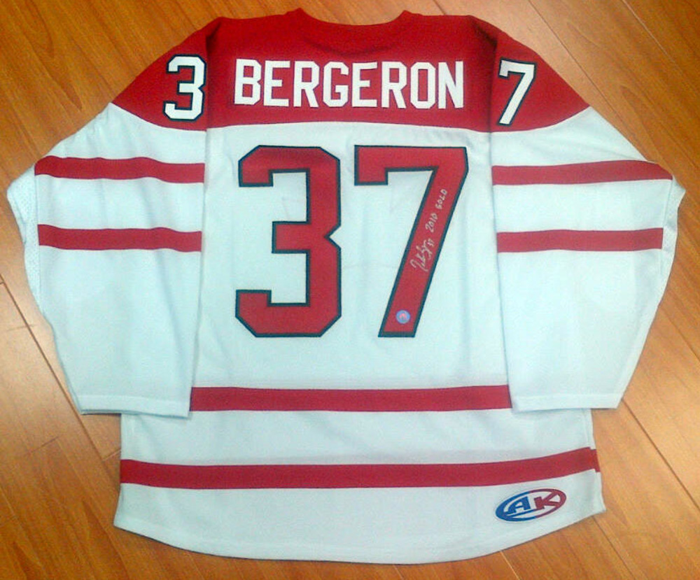PATRICE BERGERON Team Canada AUTOGRAPHED Athletic Knit Hockey Jersey w/ *2010 Gold* Inscription