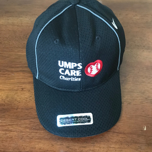 Photo of UMPS CARE AUCTION: UMPS CARE Antigua Motion Flex Cap, Black, Size L/XL