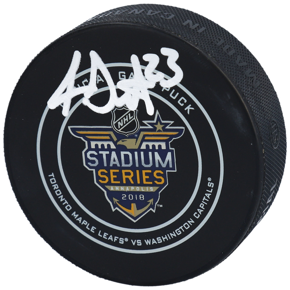 Travis Dermott Toronto Maple Leafs Autographed 2018 Stadium Series Official Game Puck - NHL Auctions Exclusive