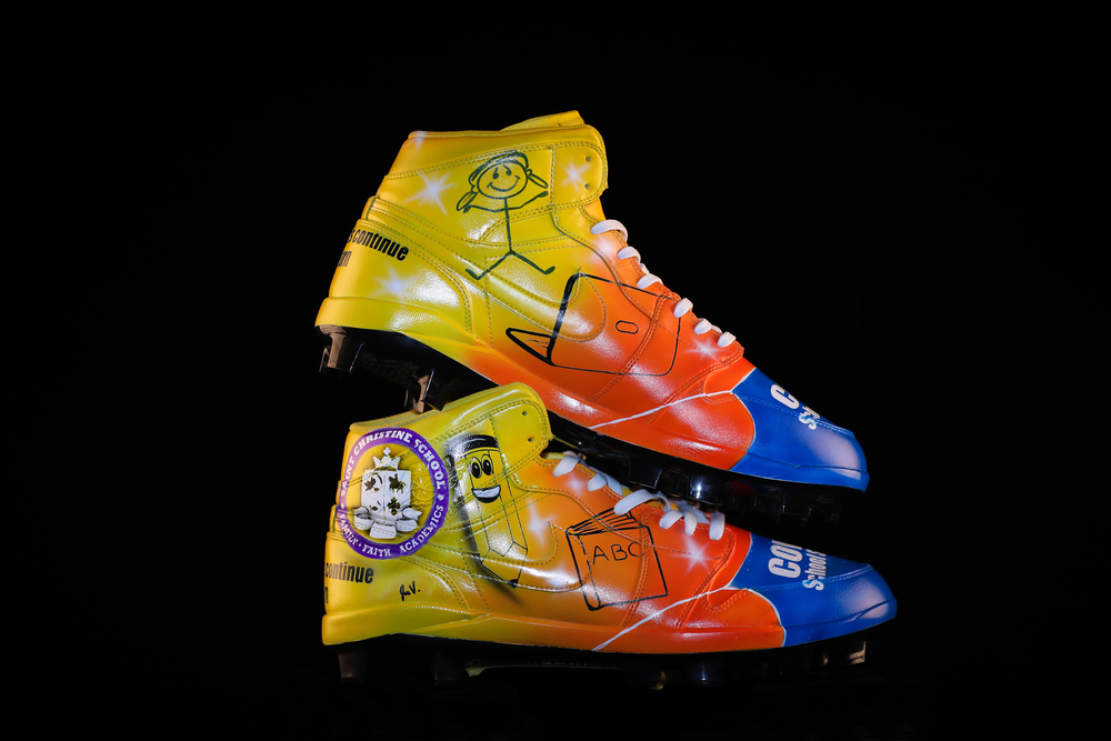 My Cause My Cleats - Patriots John Simon custom cleats supporting - St. Christine Catholic School - Cleats will be autographed