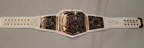 Photo of Rhea Ripley and Toni Storm SIGNED NXT Women's United Kingdom Championship Replica Title