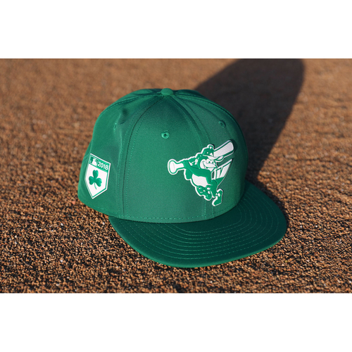 "Photo of Trey Mancini Autographed, Game-Worn ""Go Green"" St. Patrick's Day Cap"