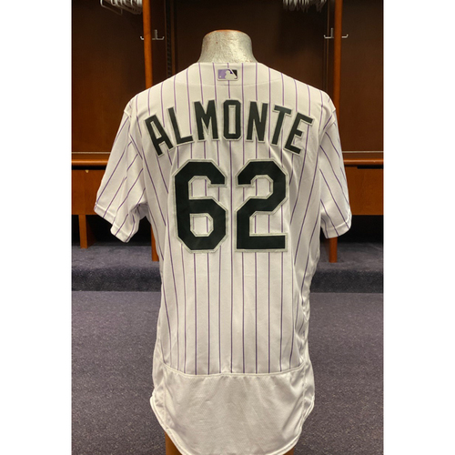 Photo of Colorado Rockies Game-Used 2020 Jersey (First Career Save) and Team-Issued Cap: Yency Almonte