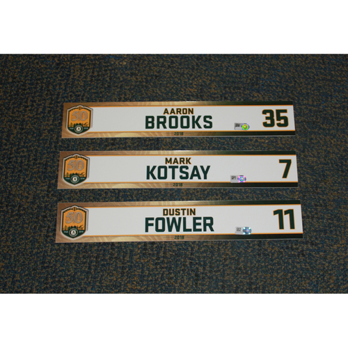 Photo of Dustin Fowler, Mark Kotsay & Aaron Brooks 2018 Locker Nameplates