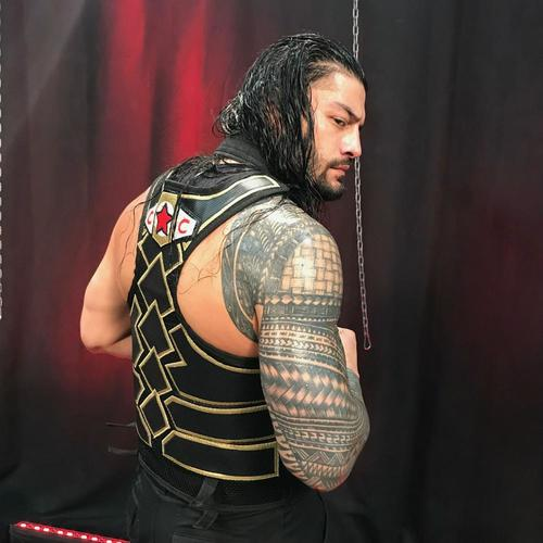 Photo of Roman Reigns WORN & SIGNED Vest (Connor's Cure: Hell in a Cell - 09/16/18)