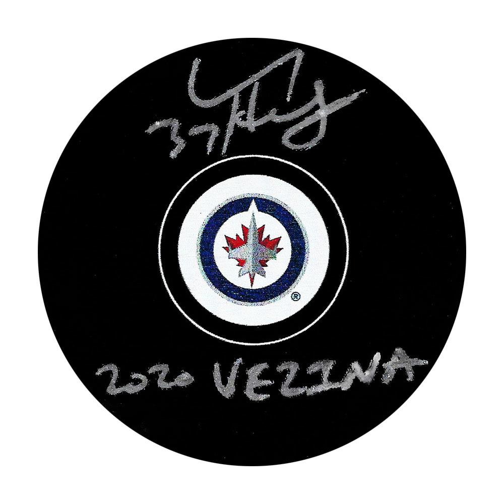 Connor Hellebuyck Autographed Winnipeg Jets Puck w/2020 VEZINA Inscription