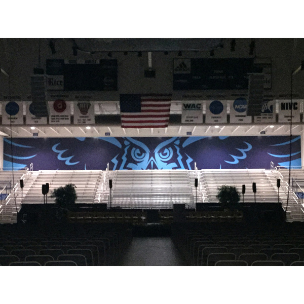 Photo of Large Owl Logo Backdrop Banner From Tudor Fieldhouse Student Section