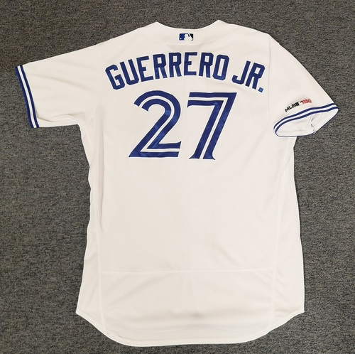 Photo of Authenticated Game Used Jersey: #27 Vladimir Guerrero Jr. (Used for 1st Career MLB Home Run at Home(5th Career HR) on May 22, 19 vs BOS and HR Games on Jun 5 vs NYY and Jun 29 vs KCR). Size 48. Rookie Season