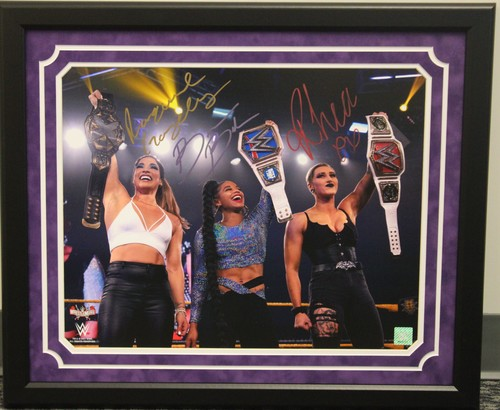 Photo of Raquel Gonzalez, Bianca Belair, and Rhea Ripley SIGNED 16x20 Framed Photo