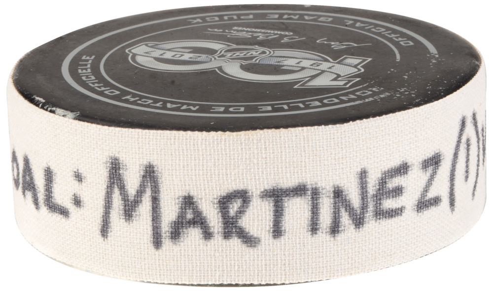 Alec Martinez Los Angeles Kings Game-Used Goal Puck from September 21, 2017 vs. Vancouver Canucks in Shanghai, China
