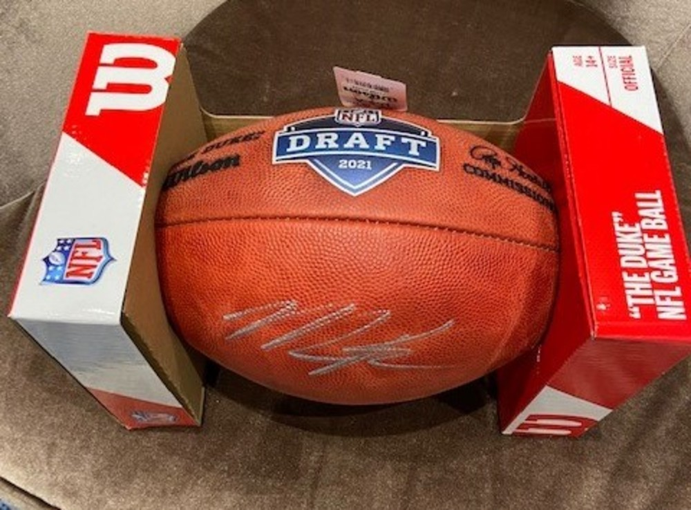 Micah Parsons autographed football with 2021 NFL Draft logo