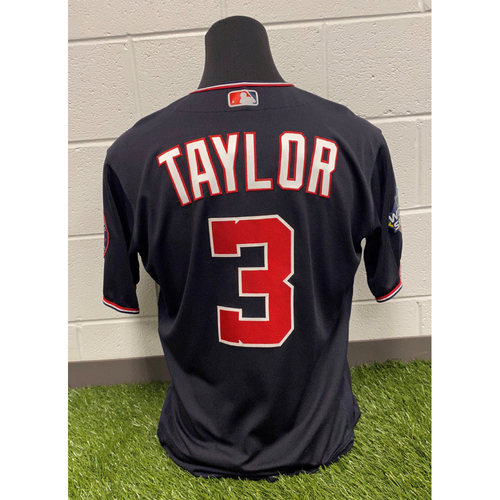 Photo of Game-Used Michael A. Taylor Navy Script Jersey - Worn World Series Games 1, 2, 5, 6, and 7
