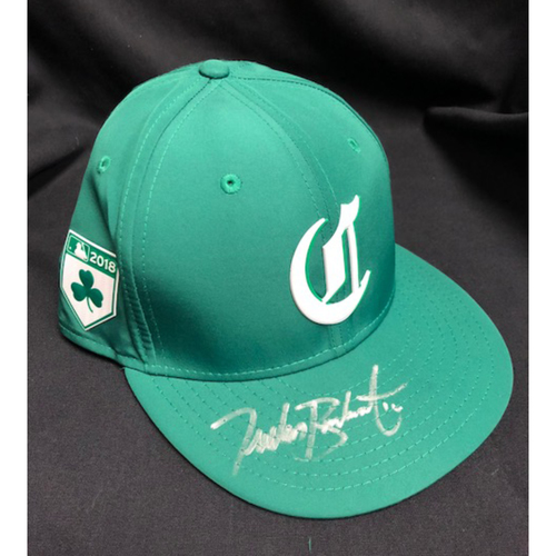 Photo of Tucker Barnhart -- Autographed -- Reds St. Patrick's Day Cap -- Game-Used