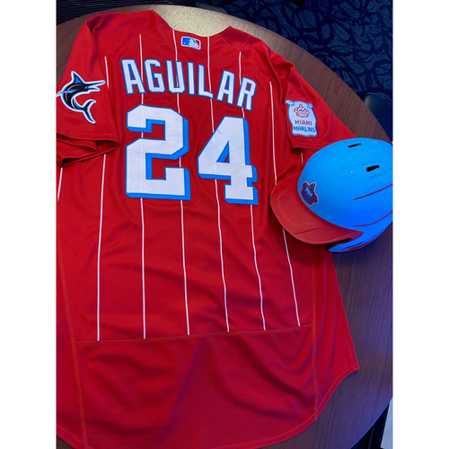 Photo of Miami Marlins City Connect Game-Used Jersey & Game-Used Batting Helmet from Jesus Aguilar