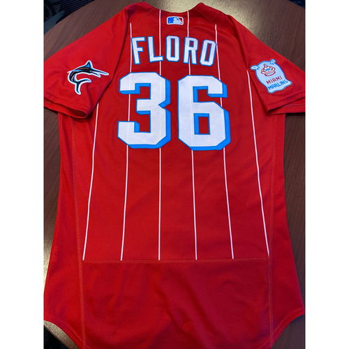 Photo of Miami Marlins City Connect Game-Used Jersey & Game-Used Cap from Dylan Floro