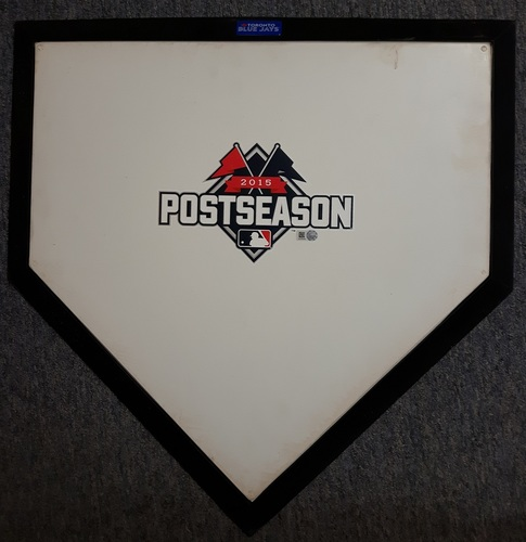 Photo of Authenticated Ceremonial Home Plate - ALCS Game 5 (October 21, 2015). Ceremonial first pitch thrown out by Vernon Wells to Mark Buehrle.