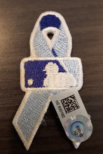 Photo of Authenticated Father's Day Ribbon Patch - #3 Ezequiel Carrera (June 21, 2015). Carrera went 2-for-4 with 1 HR, 1 Run and 3 RBIs. 1st HR as a Blue Jay. Approximately 2 inches in length by 1 inch in width.