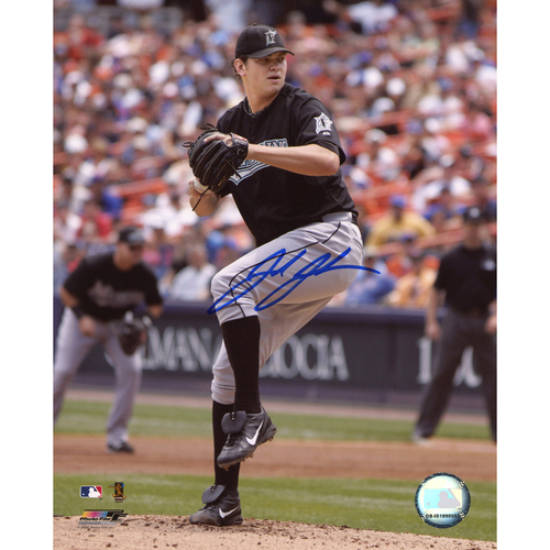 Photo of Josh Johnson Miami Marlins Autographed 8'' x 10'' Ball In Glove Photograph