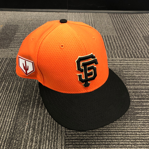 Photo of 2019 Game Used Orange Spring Training Cap worn by #51 Mac Williamson - Size 7 3/8