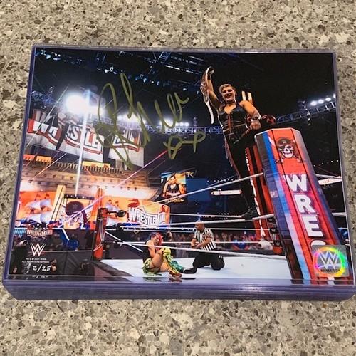 Photo of Rhea Ripley SIGNED WrestleMania 37 8x10 Photo Gold Signature (Random Number)
