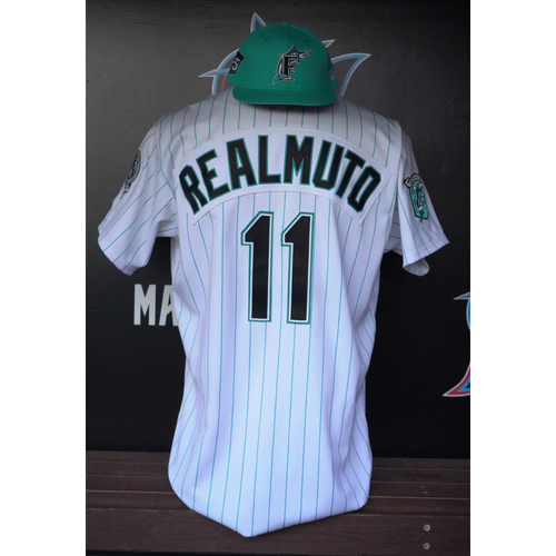 Photo of Game-Used Jersey & Cap: J.T. Realmuto - 2018 Florida Marlins Throwback Weekend - Size: 48 & 7 1/4