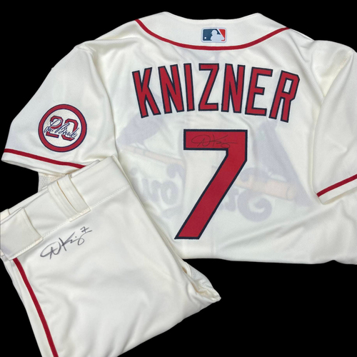 Photo of Andrew Knizner Autographed Team Issued Home Alternate Jersey w/ Lou Patch (Size 46) and Autographed Team Issued Home Alternate Pants (Size 36)