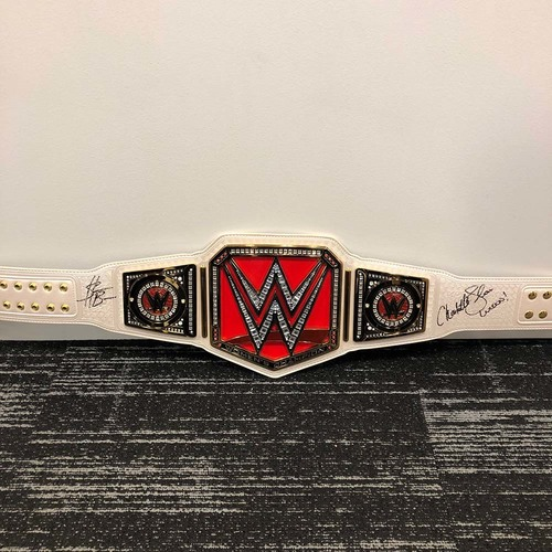 Photo of Charlotte Flair & Sasha Banks SIGNED WWE RAW Women's Championship Replica Title