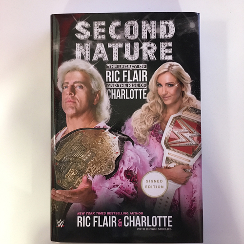 "Photo of Ric & Charlotte Flair SIGNED copy of ""Second Nature: The Legacy of Ric Flair and the Rise of Charlotte"" Hardcover Book"