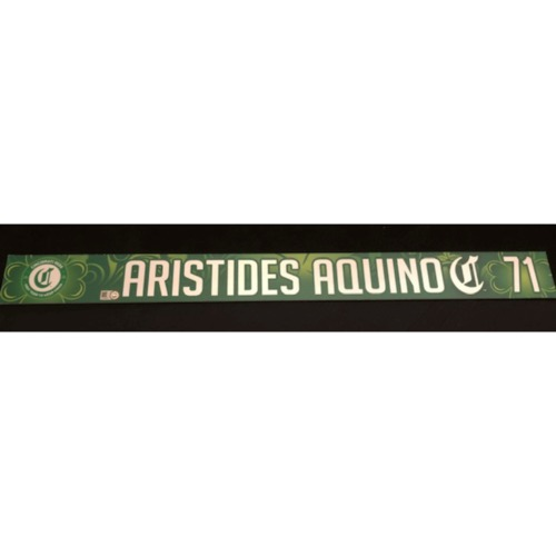 Photo of Aristides Aquino -- Team-Issued Locker Name Plate -- 2019 St. Patrick's Day