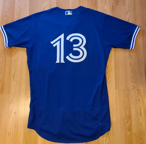 Photo of Authenticated Game Used Spring Training Jersey: #13 Lourdes Gurriel Jr. (Mar 26, 2021: 0-for-2 with 1 BB). Size 44.
