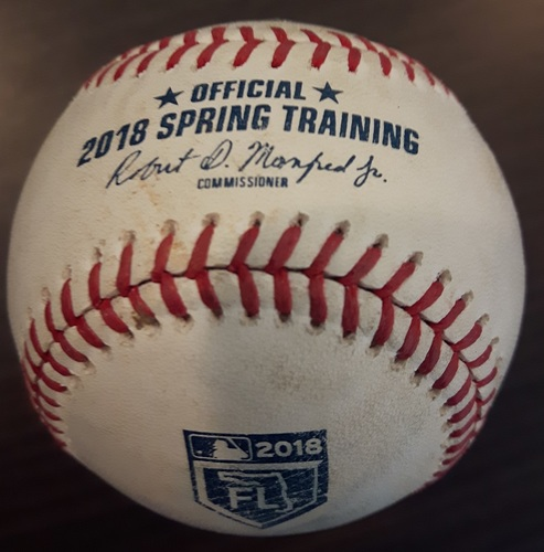 Photo of Authenticated Game Used Spring Training Baseball - Marcell Ozuna from Marcus Stroman; top of the second inning.  Strikeout (March 26, 2018 in Montreal)