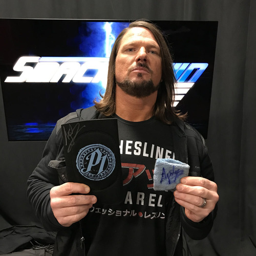 Photo of AJ Styles WORN & SIGNED Elbow Pad & Sweatband (Royal Rumble - 01/28/18)