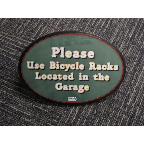 "Photo of ""Please Use Bicycle Racks Located in the Garage"" - Approximately 7""x10"""