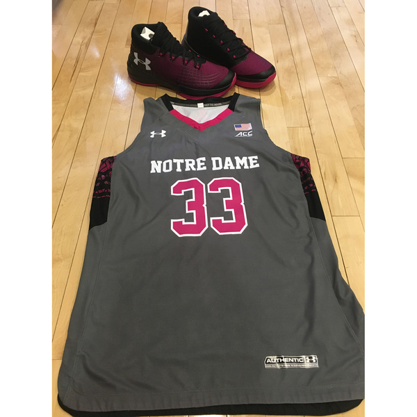 Photo of Notre Dame Women's Basketball 2016-2017 Pink Game Jersey #33 & Under Armour Shoes