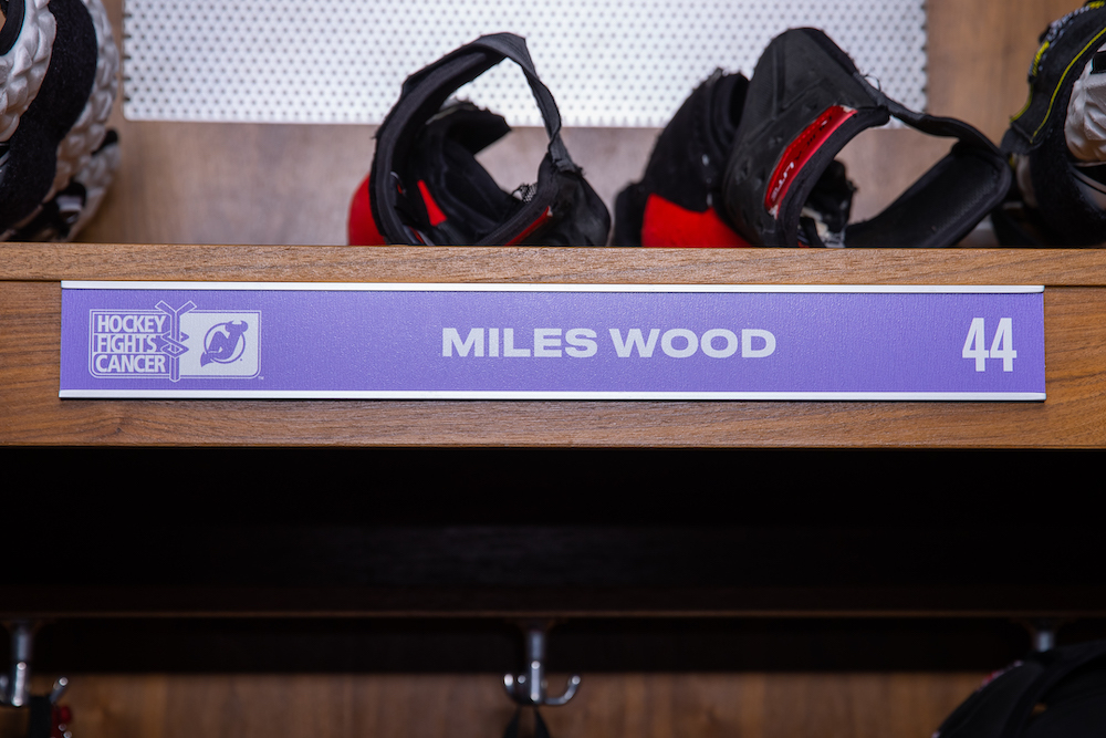 Miles Wood Autographed 2020-21 Hockey Fights Cancer Locker Room Nameplate - New Jersey Devils