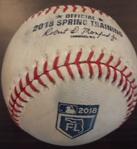 Photo of Authenticated Game Used Spring Training Baseball - Marcell Ozuna from Joe Biagini; top of second inning.  Single (March 27, 2018 in Montreal)