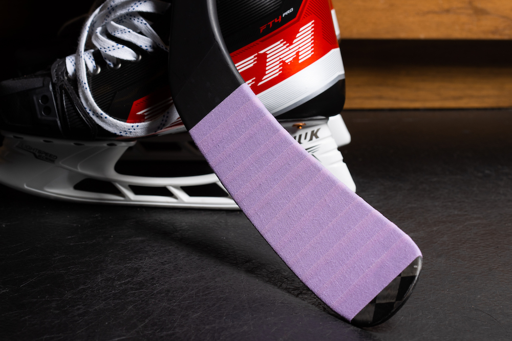 Aaron Dell Autographed 2020-21 Hockey Fights Cancer Lavender Taped Stick - New Jersey Devils