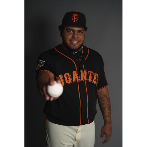 "Photo of San Francisco Giants - 2018 Black Alternate ""Gigantes"" Game-Used Jersey - Reyes Moronta (size 50)"