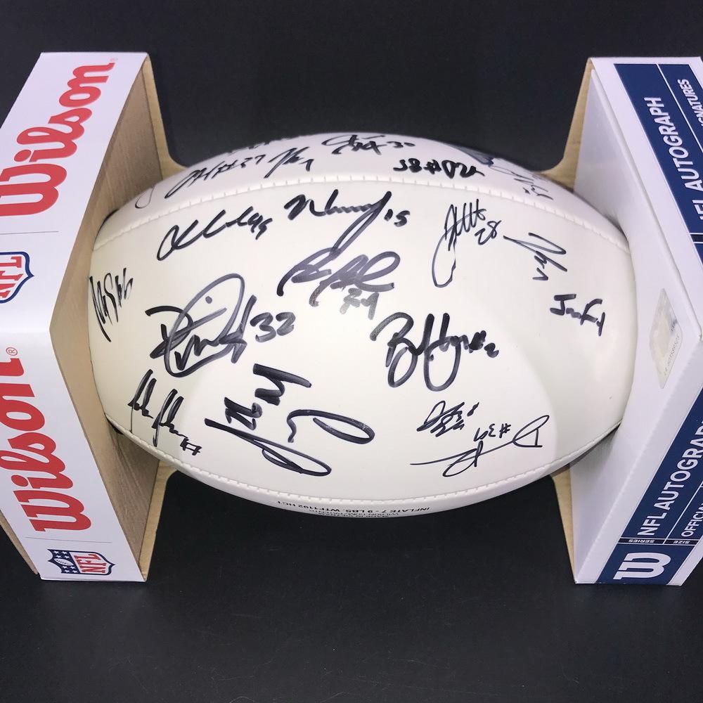 Patriots - Panel Ball with Patriots Logo Signed by # 11 Julian Edelman, #2 Brian Hoyer, #4 Jarrett Stidam, # 5 Justin Rohrwasser, #6 Nick Folk #7 Jake Bailey, # 8 Jake Dolegala, # 13 Mason King, # 15 N'Keal Harry, # 16 Jakobi Meyers, #18 Matthew Slater, #
