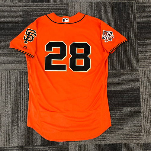 Photo of 2018 Game Used Orange Home Alt Jersey worn by #28 Buster Posey on 7/13 vs. Oakland Athletics & 8/10 vs. Pittsburgh Pirates - 6-9, 5 RBI, 1 R, 2B - Size 46