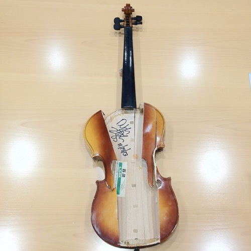 Pieces of broken fiddle used and signed by Dolph Ziggler in the