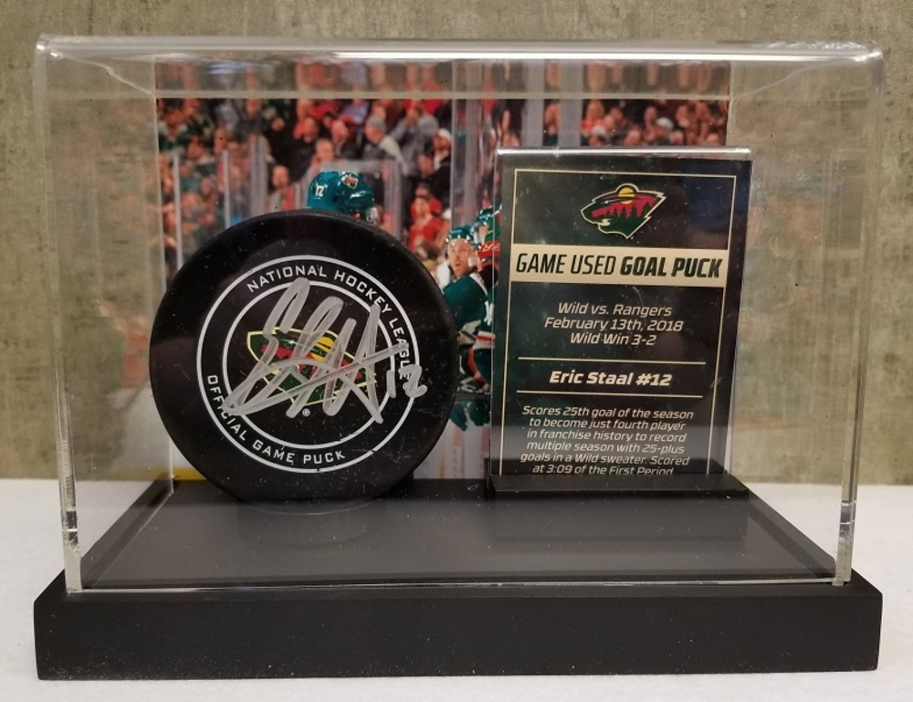 Wild Game Used Goal Puck- Staal 25th goal of 17-18 season, 4th in Wild history to record multiple 25 goal seasons