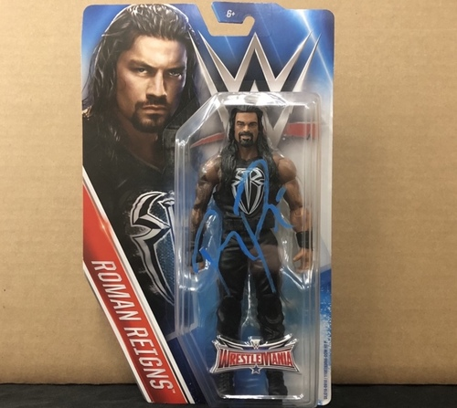 Photo of Roman Reigns SIGNED WM32 Action Figure