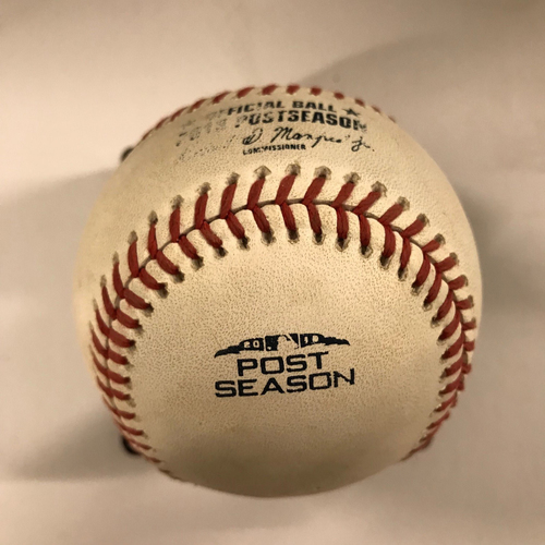 Photo of Game-Used Baseball - NLDS Game 4, 10/8/18 - Mike Foltynewicz pitched to Yasmani Grandal (Pop Out) and Kike Hernandez (Ball)