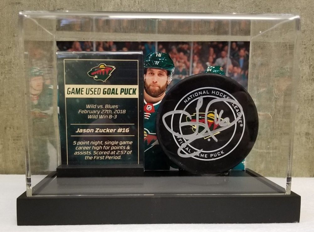 Wild Game Used Goal Puck-Zucker 5 Point Night, career high for points & assists